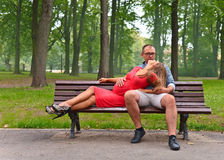 Pregnant woman  with her husband in park Stock Photo