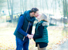 Pregnant woman with her husband in the park Royalty Free Stock Photo