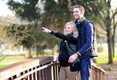 Pregnant woman with her husband in the park Stock Photography