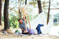 Pregnant woman with her husband at  picnic Royalty Free Stock Image