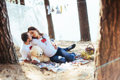 Pregnant woman with her husband at a picnic. Royalty Free Stock Photos
