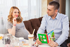 Pregnant woman and her husband Stock Images