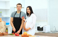 Pregnant woman with her husband preparing Royalty Free Stock Image