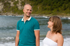 Pregnant woman and her husband by the sea. Royalty Free Stock Photography