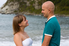 Pregnant woman and her husband by the sea. Stock Images