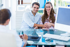 Pregnant woman and her husband smiling at camera Stock Photography