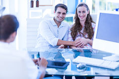 Pregnant woman and her husband smiling at camera Royalty Free Stock Photos