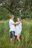 Pregnant woman and her man Stock Photography