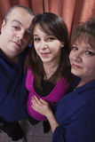 Pregnant woman with her parents Stock Image