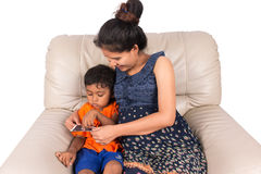 Pregnant woman and her son stock images