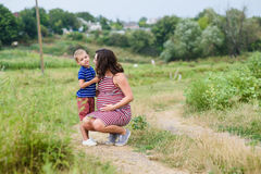 Pregnant woman with her son Royalty Free Stock Image