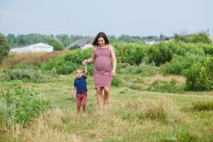 Pregnant woman with her son Royalty Free Stock Images