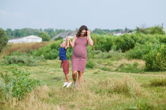 Pregnant woman with her son Stock Photos