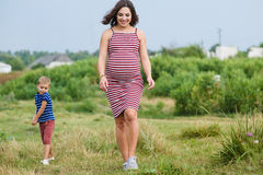 Pregnant woman with her son Stock Photo