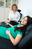 Pregnant woman and her therapist Stock Photos