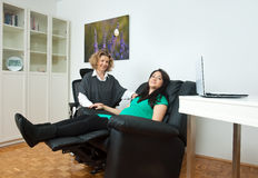 Pregnant woman and her therapist. Pregnant women at prenatal psychological therapy with her therapist Stock Photo