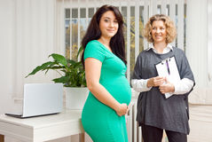 Pregnant woman and her therapist. Pregnant women at prenatal psychological therapy with her therapist Royalty Free Stock Photography