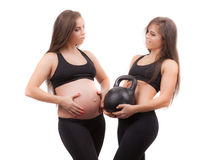 Pregnant woman with her twin sister Stock Photos