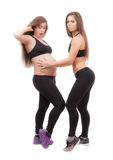 Pregnant woman with her twin sister Royalty Free Stock Photos