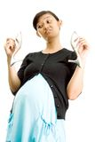 Pregnant woman and high heel shoes Royalty Free Stock Images