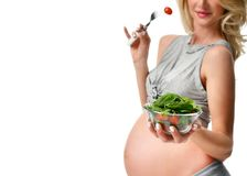 Pregnant woman hold organic salad. Pregnancy motherhood expectation healthy eating Stock Photography