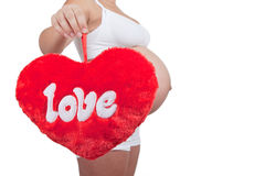 Pregnant woman hold red hart with love in hands Stock Image