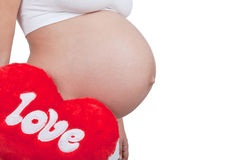 Pregnant woman hold red hart with love in hands royalty free stock photos