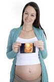 Pregnant woman holding 4d scan Royalty Free Stock Images