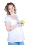 Pregnant woman holding apple royalty free stock photography