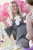 Pregnant Woman Holding Artificial Baby Clothes Royalty Free Stock Image
