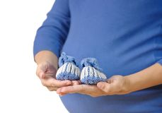 Pregnant woman holding baby booties Stock Photography