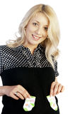 Pregnant woman holding baby's socks royalty free stock image