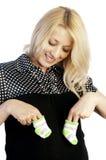Pregnant woman holding baby's socks Stock Photos