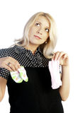 Pregnant woman holding baby's socks Stock Photography