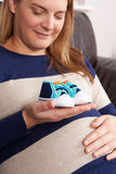 Pregnant Woman Holding Baby Shoes Royalty Free Stock Image