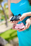 Pregnant woman holding baby shoes Royalty Free Stock Photography