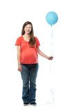 Pregnant Woman holding a balloon Royalty Free Stock Image