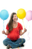 Pregnant Woman holding balloons Royalty Free Stock Image