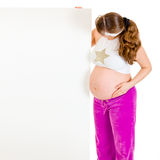 Pregnant woman holding blank billboard isolated Royalty Free Stock Photography