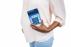 Pregnant woman holding calculator Royalty Free Stock Images
