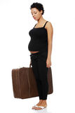 Pregnant woman holding a case. Stock Photo