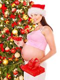 Pregnant  woman holding Christmas box. Stock Photography