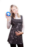 Pregnant woman holding clock royalty free stock images