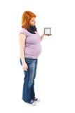 Pregnant woman holding a clock stock photos