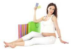 Pregnant woman holding credit cards and bags. Stock Image