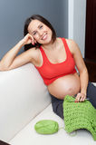 Pregnant woman holding crocheting Royalty Free Stock Photos