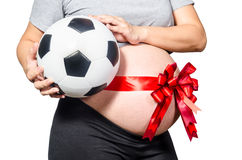 Pregnant woman holding football. expecting a boy Stock Images