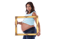 Pregnant woman holding a frame Royalty Free Stock Photo