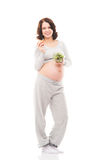 A pregnant woman holding fresh fruits Stock Images