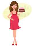 Pregnant woman holding a freshly baked cake Stock Image